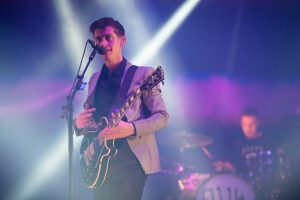 GLASTONBURY, ENGLAND - JUNE 28: Alex Turner of the Arctic Monkeys performs live on the Pyramid Stage at day 2 of the 2013 Glastonbury Festival at Worthy Farm on June 28, 2013 in Glastonbury, England. (Photo by Ian Gavan/Getty Images)